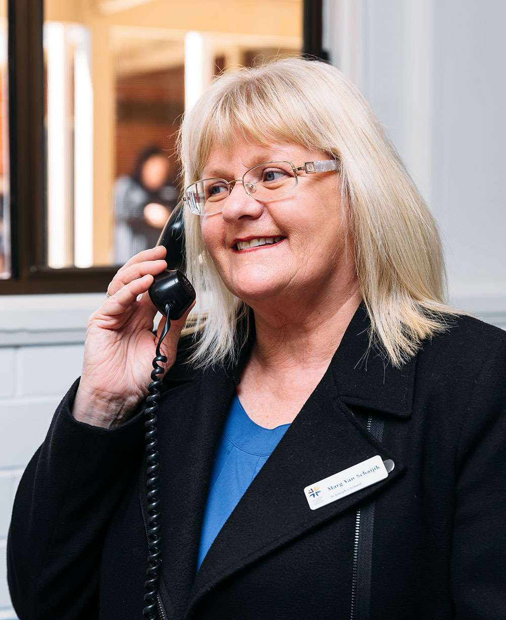 School receptionist answering phone call