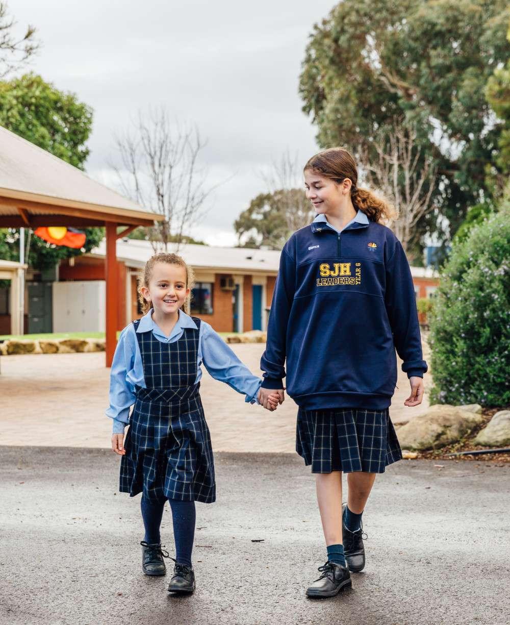 St Joseph Hectorville two girls holding hands