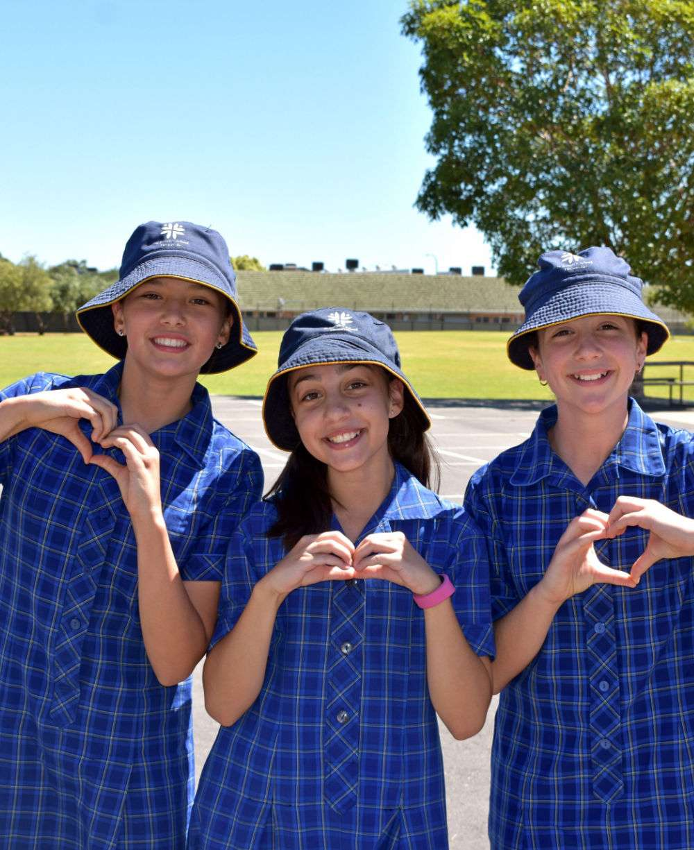 Three students with hearts
